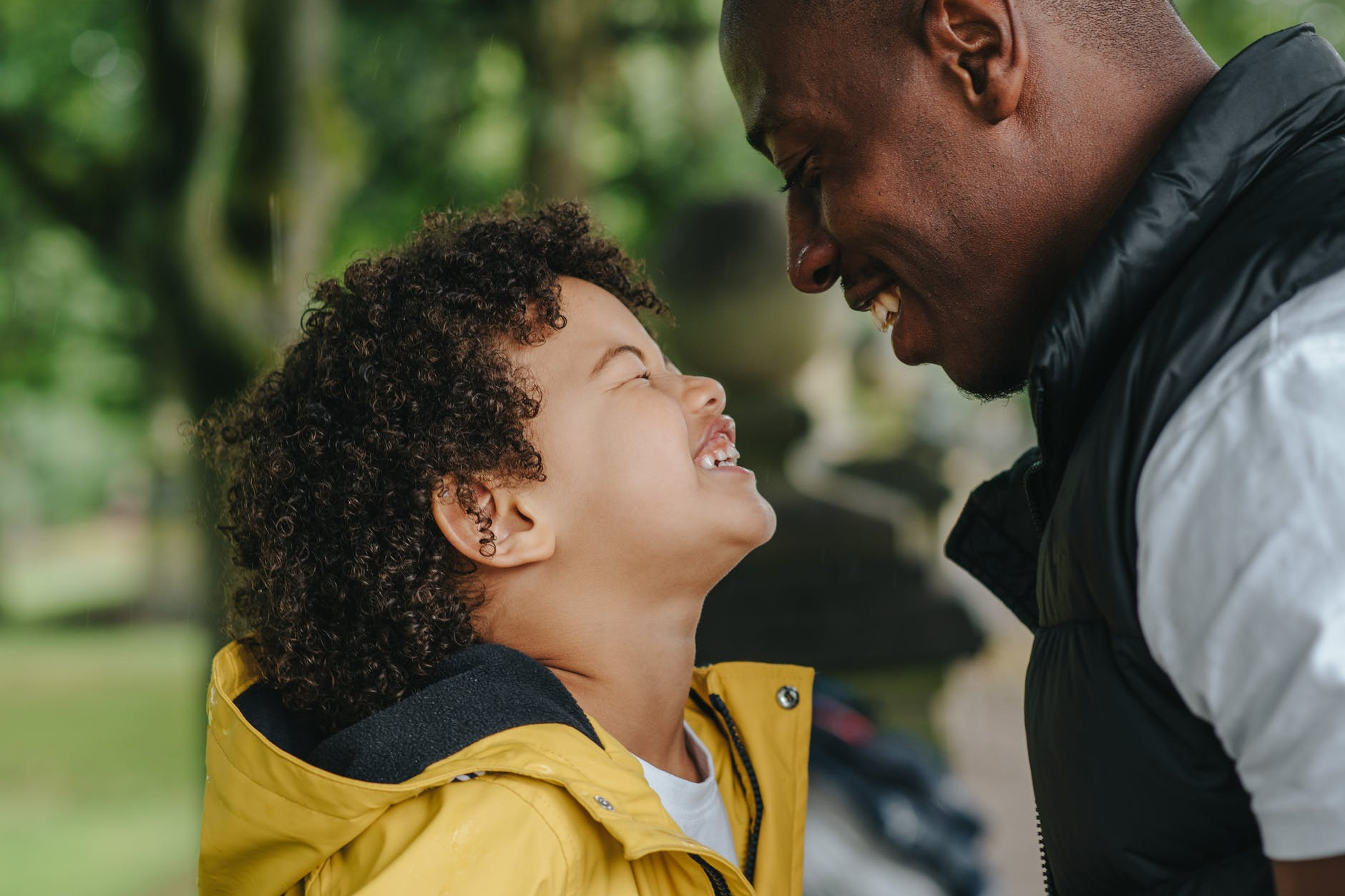 happy black father looking on little laughing sun