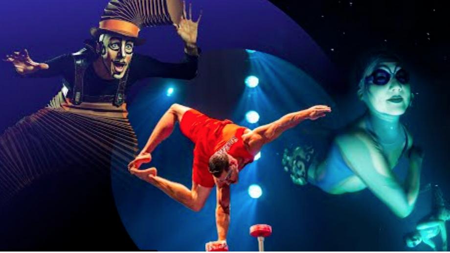 Foto de un equilibrista del Circo del Sol haciendo un equilibrio sobre una mano.